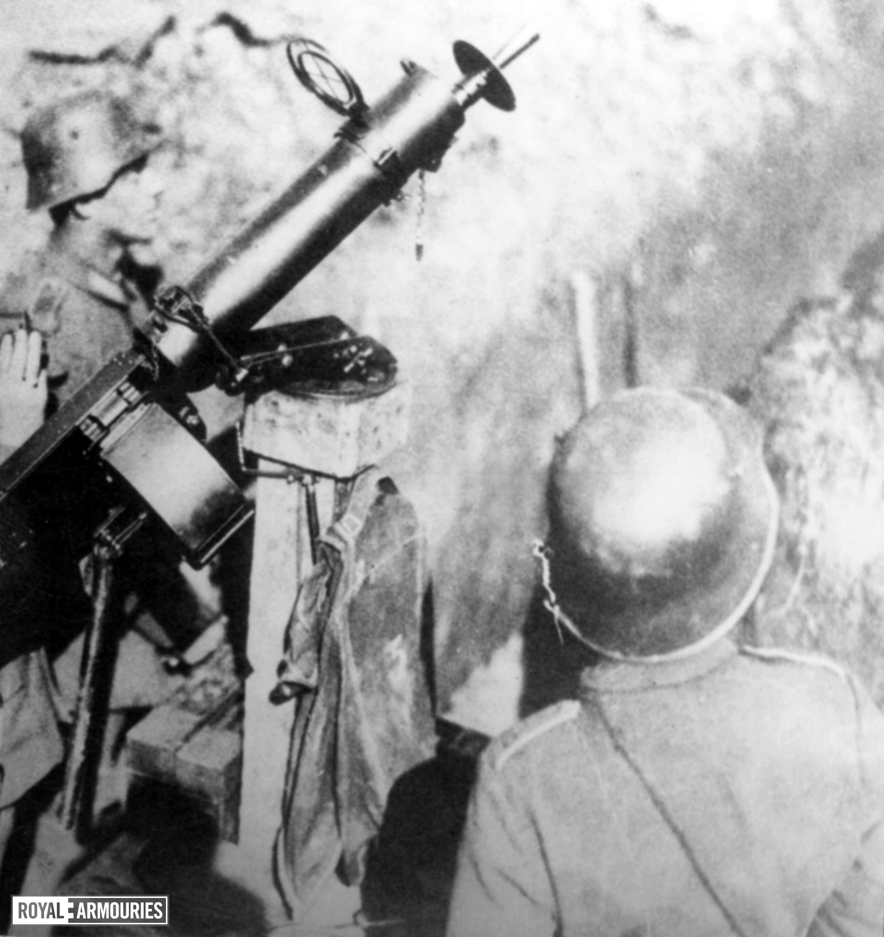 Photograph showing the German MG 08 centrefire belt fed machine gun in use by two German soldiers.