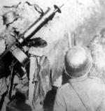 Thumbnail image of Photograph showing the German MG 08 centrefire belt fed machine gun in use by two German soldiers.