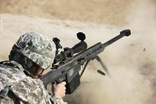 Thumbnail image of Photograph of a U.S. Army soldier firing a Barrett M82A1 rifle on a firing range, Kunduz, Afghanistan, 2012.