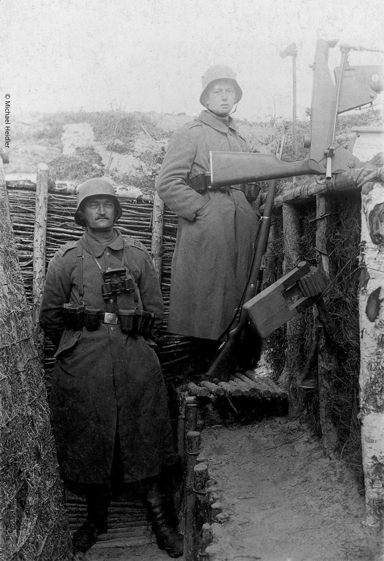 Photograph showing two German soldiers in a trench with a overhead trench fire device (Spiegelkolben): the fully developed 'Spiegelkolben' with lower bolt handle to allow reloading from cover.