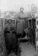 Thumbnail image of Photograph showing two German soldiers in a trench with a overhead trench fire device (Spiegelkolben): the fully developed 'Spiegelkolben' with lower bolt handle to allow reloading from cover.