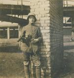 Thumbnail image of Photograph of a soldier of a German stormtrooper assault group with his Bergmann MP18.1 and a Parabellum P08, Northern France, Spring 1918.