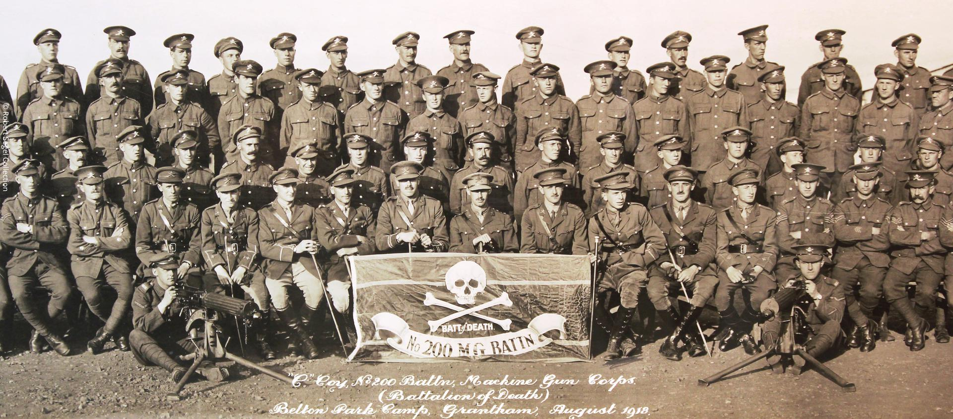 Unit photograph of the 200th 'Battalion of Death', showing their threatening unit insignia.