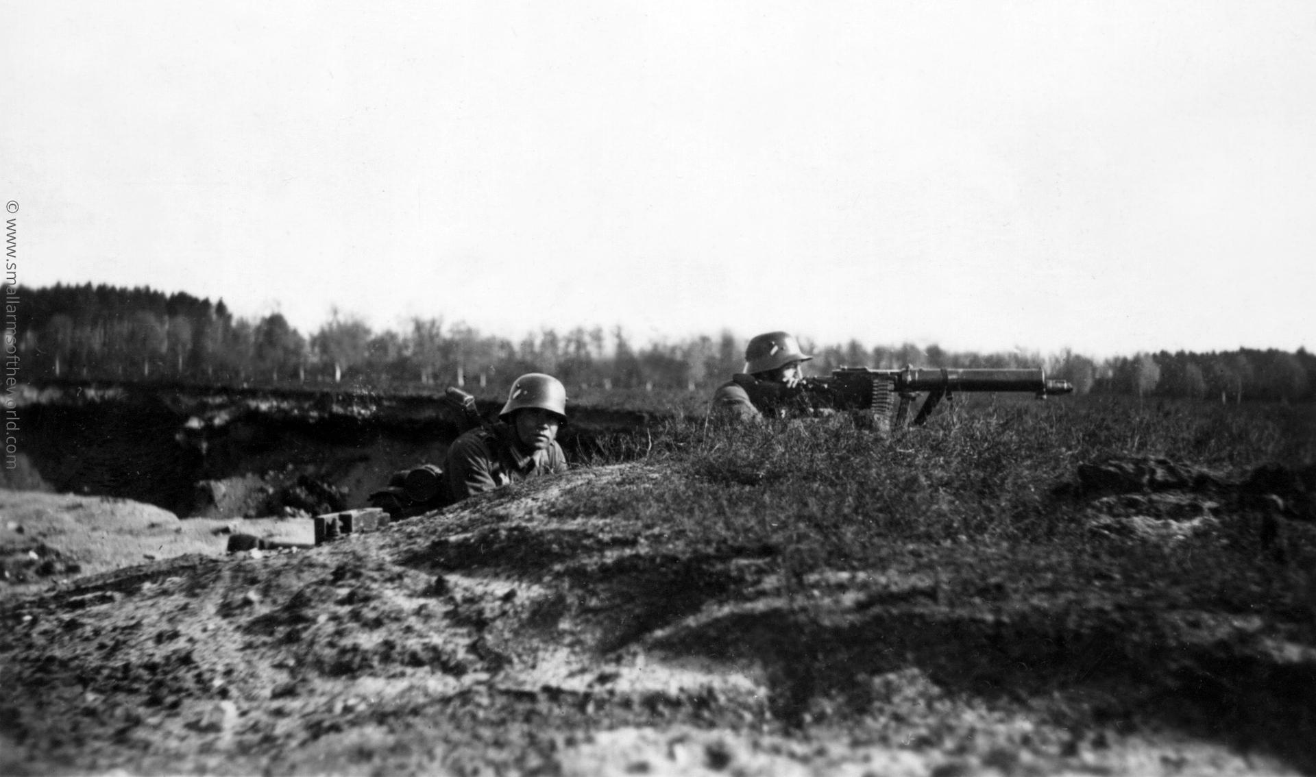 Photograph showing German gun crew firing a Maxim MG 08/15 light machine gun