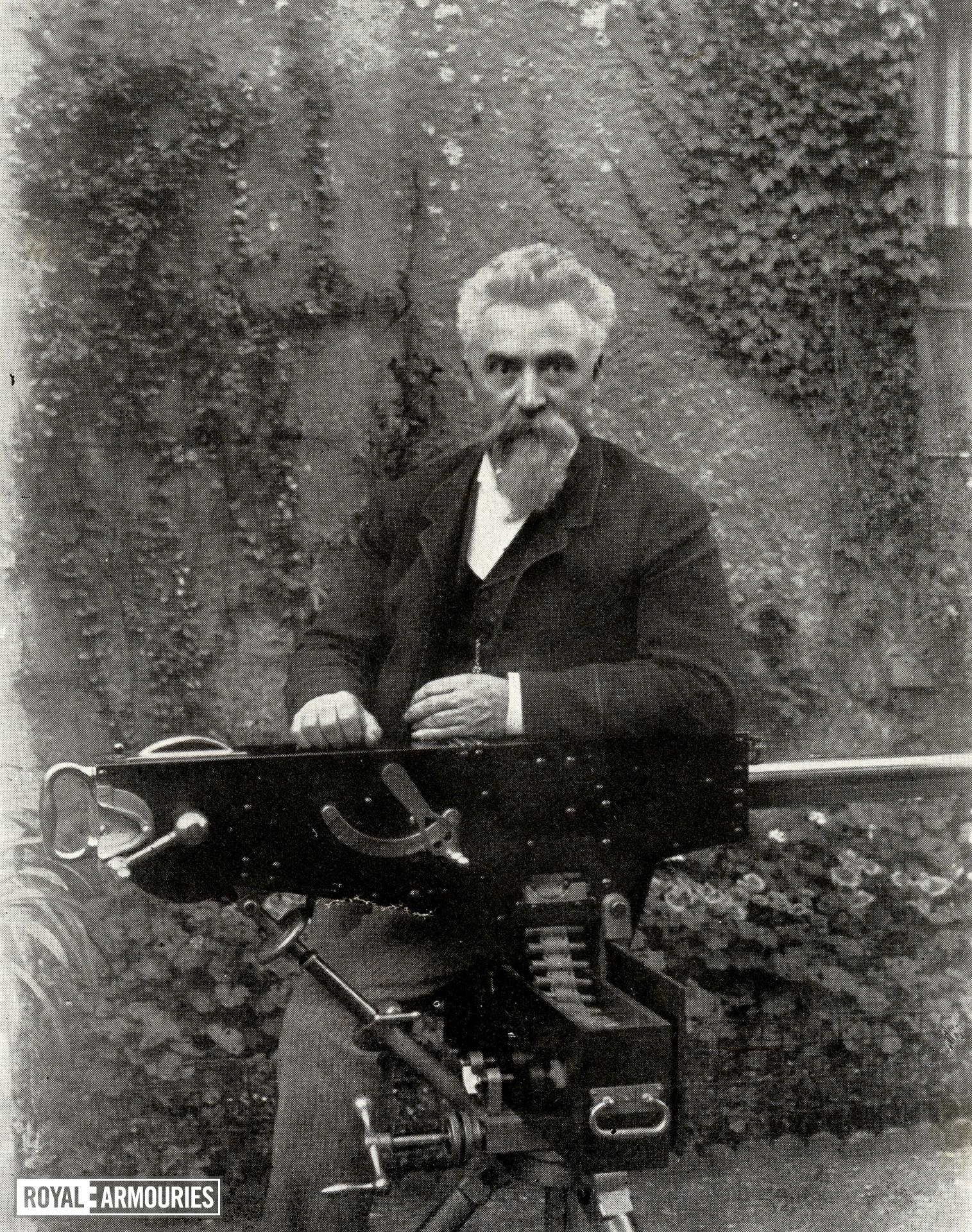 Photograph of Hiram Stevens Maxim with his original prototype gun, taken from Sir Hiram S. Maxim, My Life. London: Methuen, 1915.