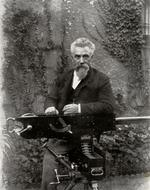 Thumbnail image of Photograph of Hiram Stevens Maxim with his original prototype gun, taken from Sir Hiram S. Maxim, My Life. London: Methuen, 1915.