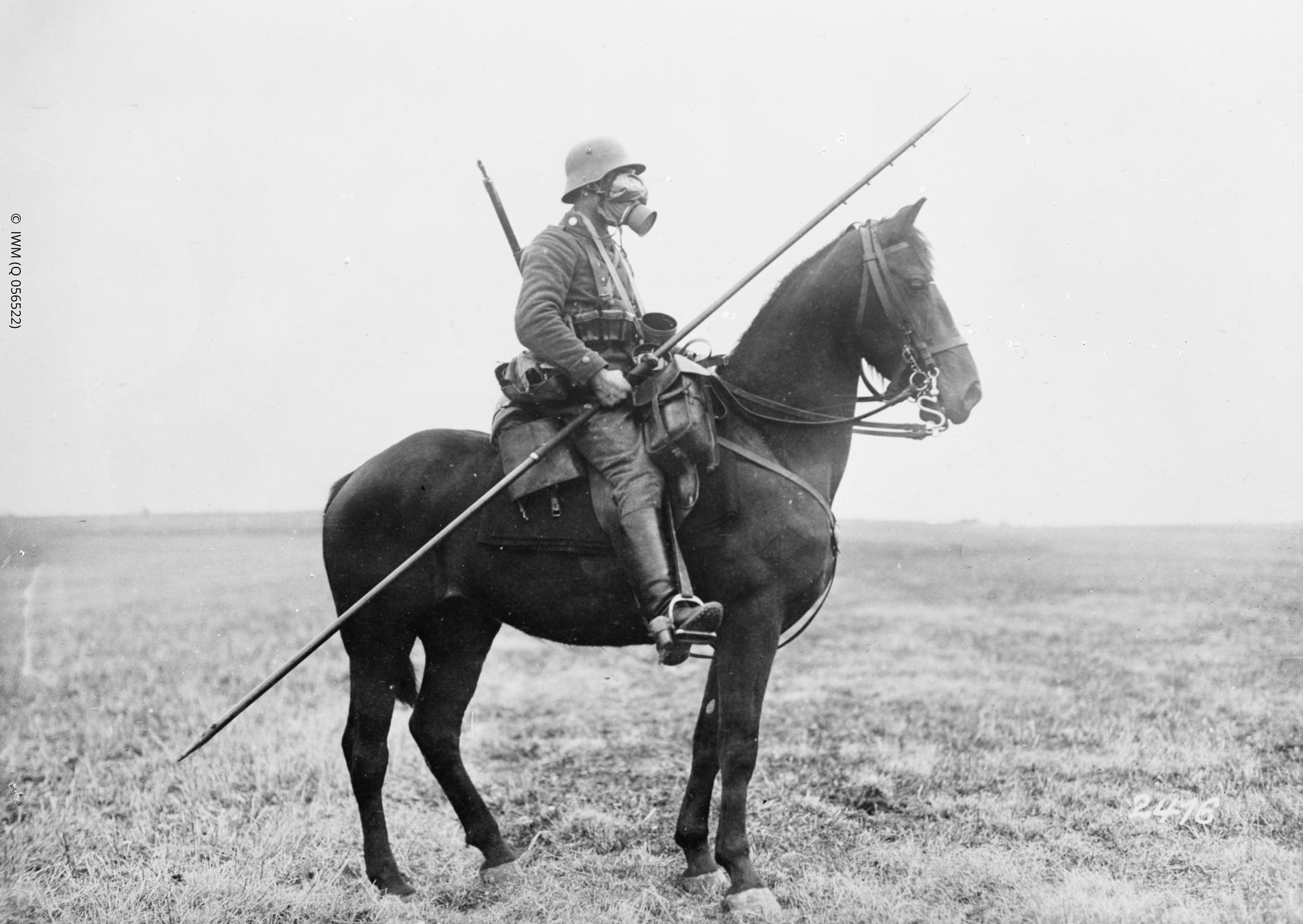 German cavalryman in battle dress with gas mask. The protruding steel eyelets for a pennant can be seen toward the point of the lance.  These could become stuck in a target, making the weapon hard to retrieve.