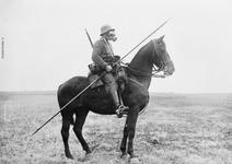 Thumbnail image of German cavalryman in battle dress with gas mask. The protruding steel eyelets for a pennant can be seen toward the point of the lance.  These could become stuck in a target, making the weapon hard to retrieve.