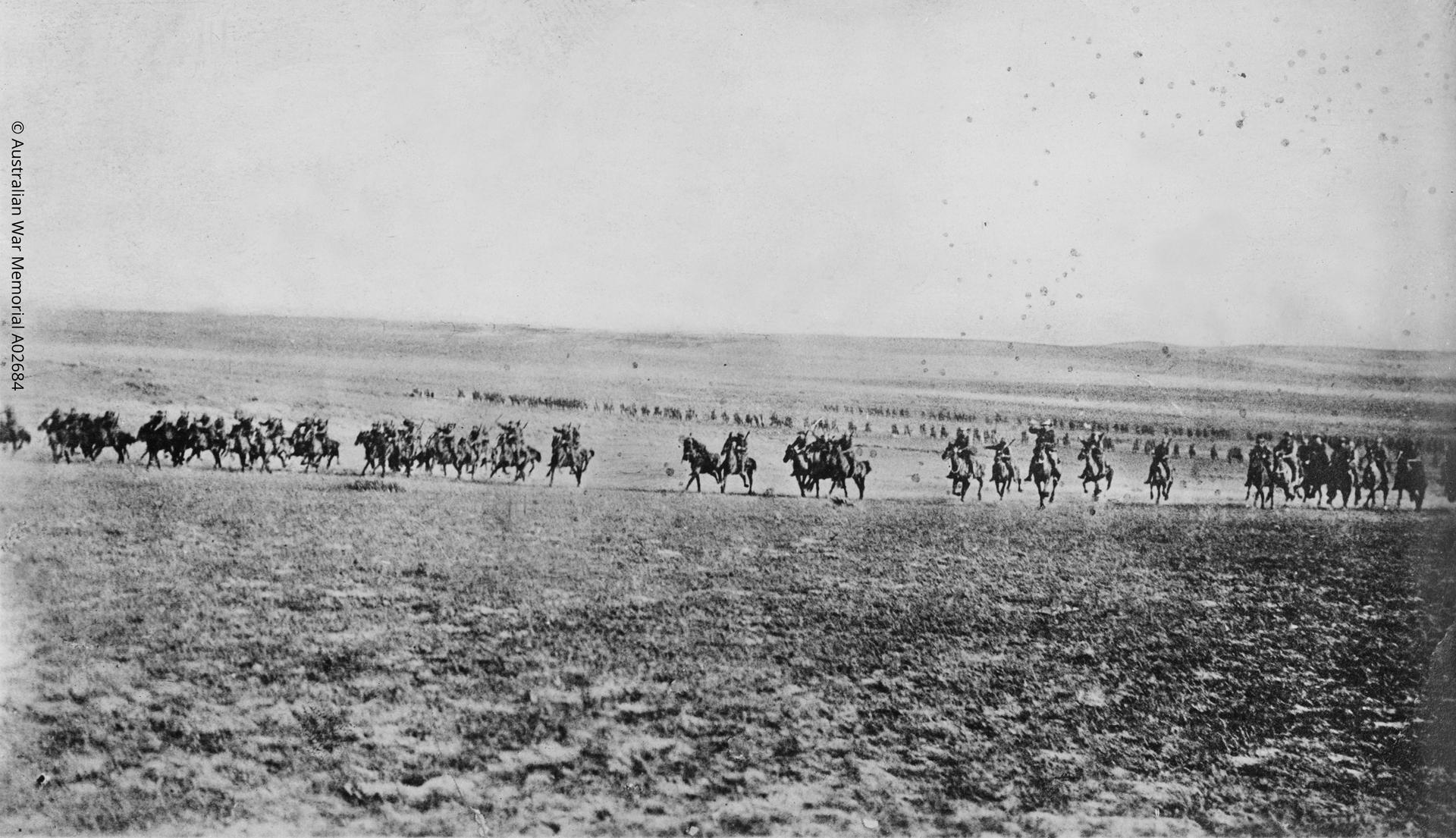 'Thunder of a light horse charge'. This photograph has been described as one of the charge of the 4th Light Horse Brigade at Beersheba on the 31st October 1917, taken by a Turk whose camera was captured later in the day. © Australian War Memorial A02684