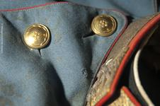 Thumbnail image of The tunic worn by the Archduke on the day of his assassination. The bullet hole is visible about 1.5 cm below the collar.