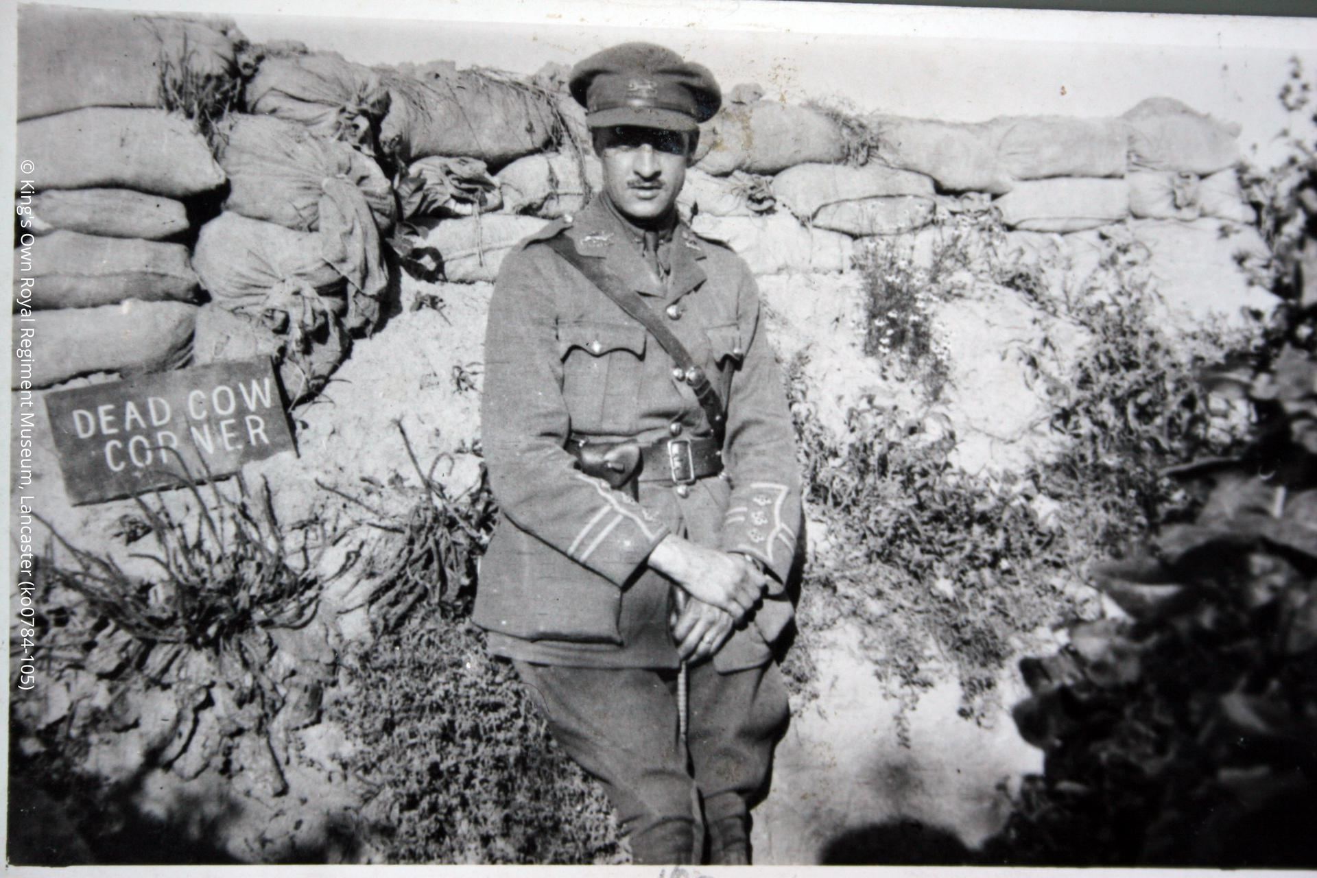 Photograph of Captain W Fawcett of the King's Own Royal Lancaster Regiment, pictured at Dead Cow Corner via Gallia trench. Fawcett was in the 1/5th Battalion, a Territorial unit, which he had joined in 1907.  Fawcett's battalion served from February 1915 until the war's end in France and Flanders and saw action in the major battles of Ypres, the Somme and Cambrai.  Fawcett survived the war and in 1919 became a Draft Conducting Officer for the battalion.