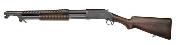 Thumbnail image of Winchester Model 1897 centrefire pump action military shotgun with model 1917 bayonet,American, 1921