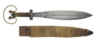 Thumbnail image of Short sword and scabbard (Trench knife), British, about 1917-1981. Used as a side arm by the 9th Service Battalion of the Royal Welsh Fusiliers.