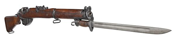 Thumbnail image of Short Magazine Lee Enfield (SMLE) Mk. III rifle, Britain, 1907. With Pattern 1907 hook guard bayonet (PR.1953) fitted.