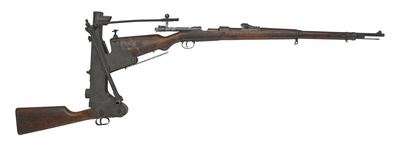 Thumbnail image of Mauser Gewehr 98 (Gew98) centrefire bolt action rifle with trench firing device, Germany, 1916. Fitted with trench firing device (XIII.1099) enabling rifles to be loaded and fired over a parapet.