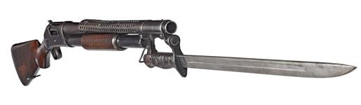 Thumbnail image of Winchester Model 1897 centrefire pump action military shotgun with model 1917 bayonet, American, 1921.