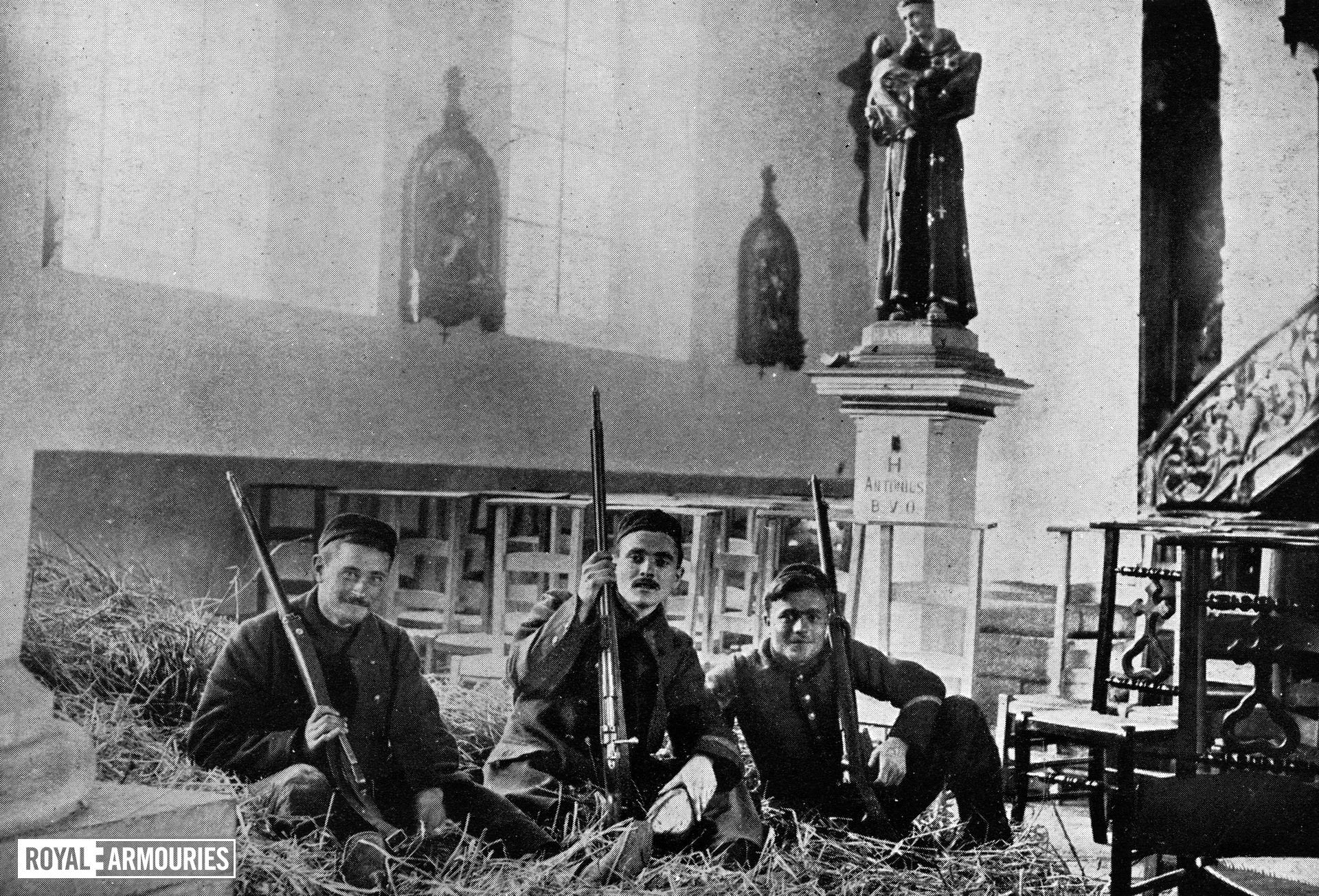 Belgian soldiers with Mauser rifles billeted at a church near Louvain, Belgium, 19 August 1914