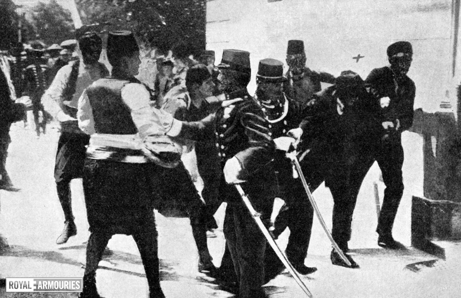 Photograph entitled , 'Arrest of Princeps, assassin of the Archduke Francis Ferdinand and the Duchess of Hohenberg,' page 3, chapter XXXVI taken from the Times History of the War Volume 2, printed and published by the Times, Printing House Square, London. 1915.