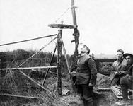 Thumbnail image of Photograph entitled ' Official Photograph taken on the Western Front. Offensive on the Camorai Front. Machine gun mounted on a wheel so that the gunner may easily swing round to follow enemy aeroplanes.' Photograph shows a Lewis machine gun mounted on an expedient mount, Britain, 1914-18.