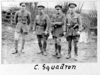Thumbnail image of Photograph of 4 officers of the 2nd Dragoon Guards armed with Webley revolvers, Western Front, 1914-1915, taken from a photograph album compiled by Captain F.D.R. Milne,  2nd Dragoon Guards (Queen's Bays) recording his service with the regiment from 1913 to 1918, and including some family photographs from the 1920s.