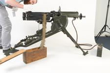 Thumbnail image of Library assistant, James Avison, helps with photography of a Maxim MG 08 centrefire automatic belt-fed machine gun (XII.11212) with sled type mount (PR.74), Germany, early 20th century at the Royal Armouries Museum, Leeds, United Kingdom, July, 2014.