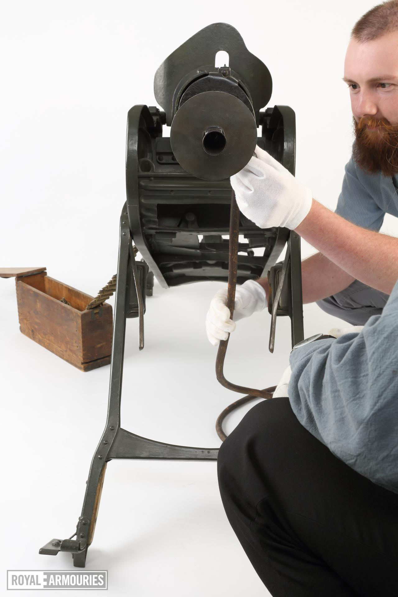 Library assistant, James Avison, helps with photography of a Maxim MG 08 centrefire automatic belt-fed machine gun (XII.11212) with sled type mount (PR.74), Germany, early 20th century at the Royal Armouries Museum, Leeds, United Kingdom, July, 2014.