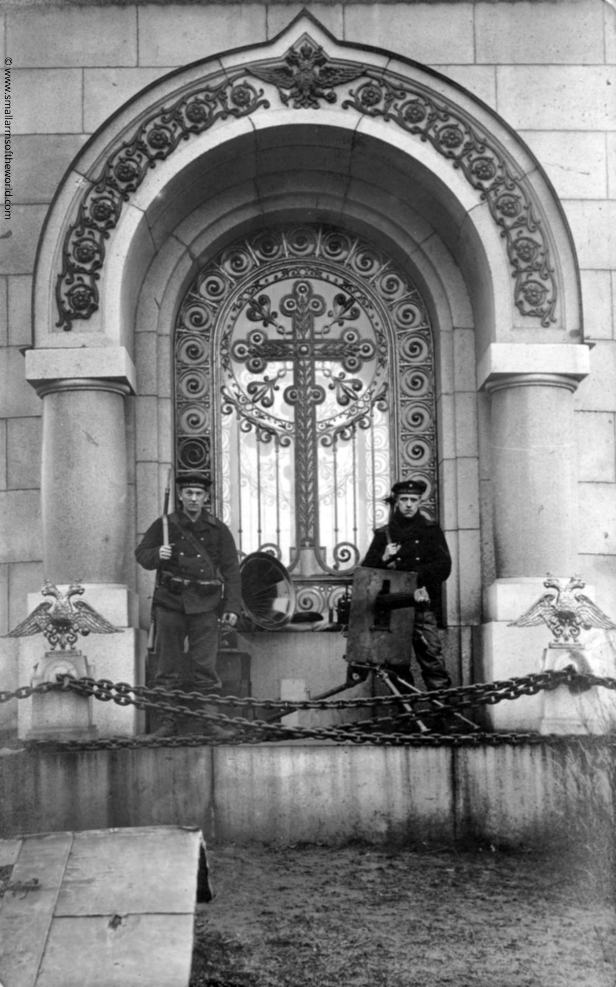 Two German Sailors off the SMS Westfalen with a Russian Model 1910 Maxim gun on shielded mount. In front of a church. The Westfalen took part in the Naval battles of Riga and also served in combat near Finland. The photo was most likely taken in Riga.