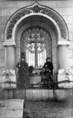 Thumbnail image of Two German Sailors off the SMS Westfalen with a Russian Model 1910 Maxim gun on shielded mount. In front of a church. The Westfalen took part in the Naval battles of Riga and also served in combat near Finland. The photo was most likely taken in Riga.