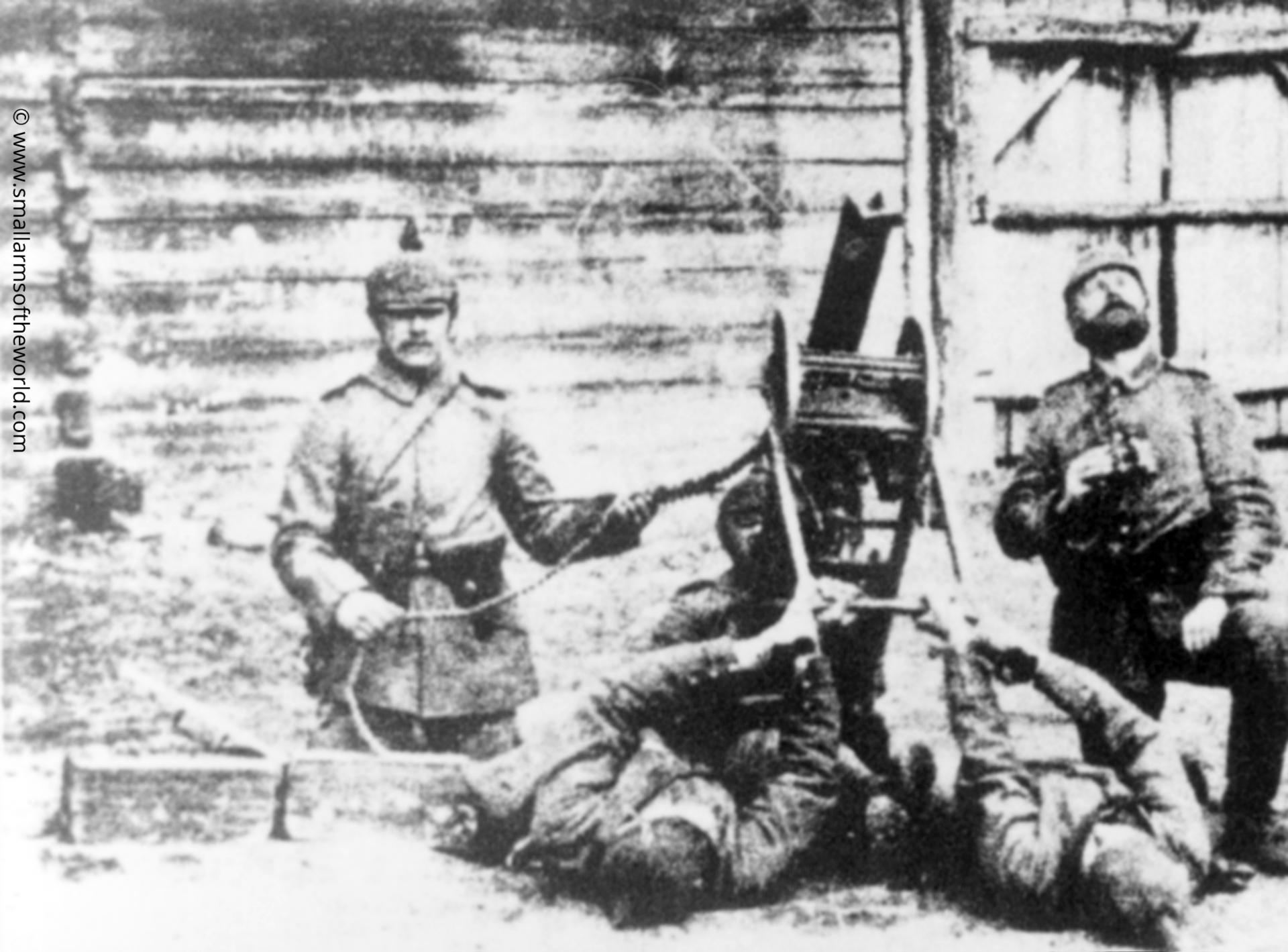 Maxim MG08. These are German Lundwehr troops using a very primitive field expedient method to achieve anti-aircraft fire. As the gun ejects its empty cases from underneath the receiver, and to the front. The men supporting the legs of the sled are keeping well to the side to avoid the fired cases, Russia, 1914.