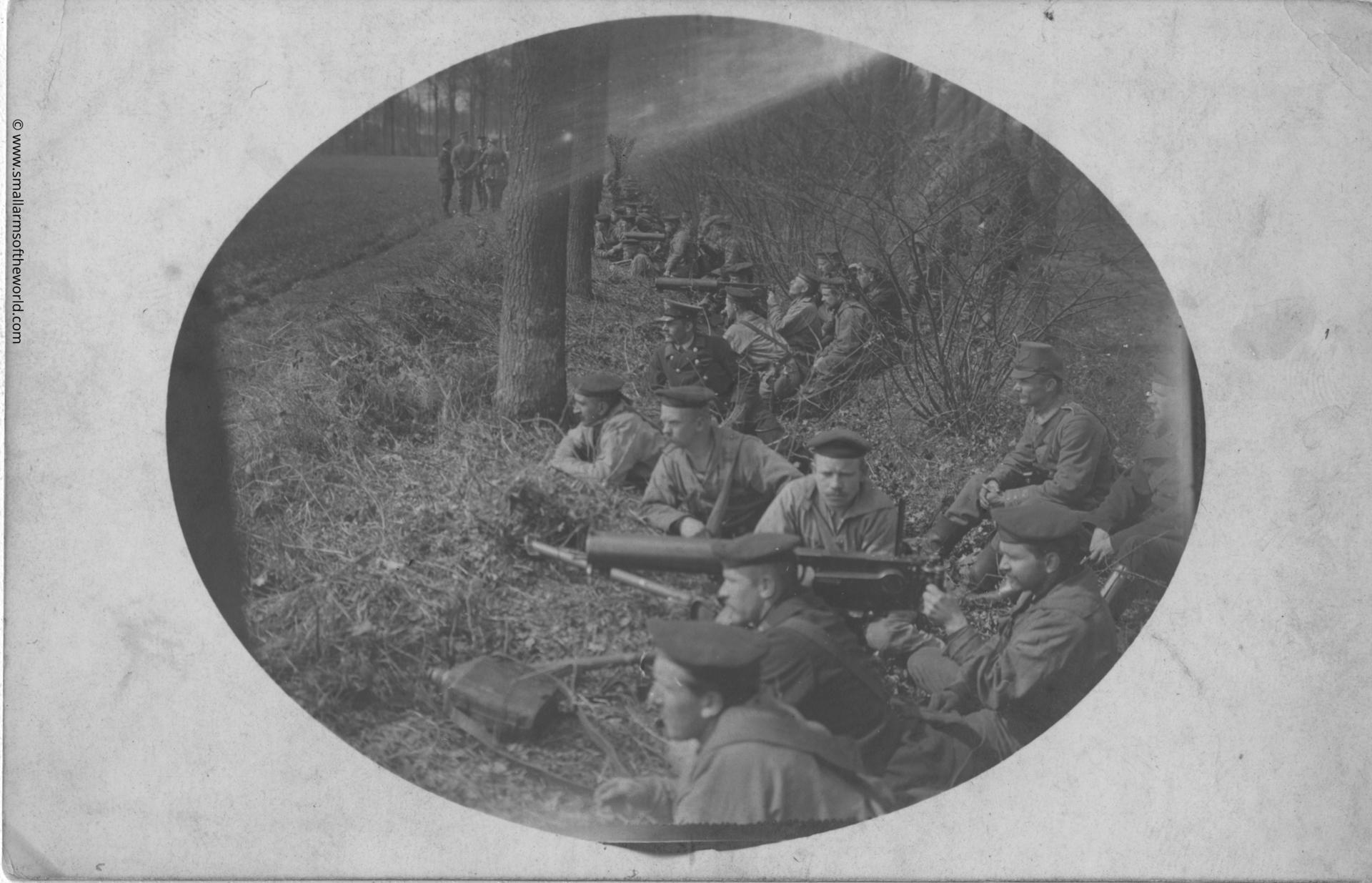 "German sailors on training manoeuvres with their Maxim MG08 machine gun on the special naval tripod. Note on the back is written in German: ""This is a small souvenir of my machine gun training - it shows a field exercise in Flanders."""