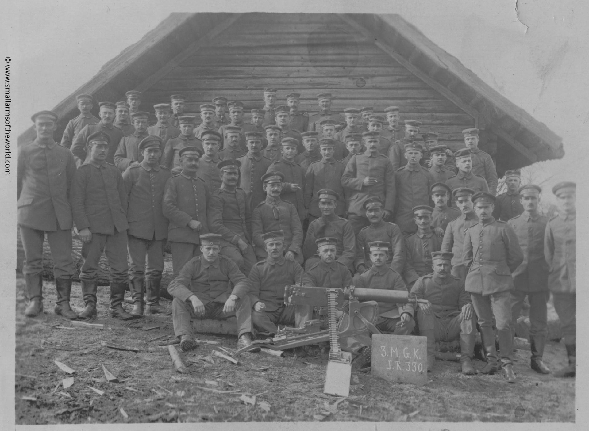 The officers and men in a machine gun company posing with their Maxim MG08 machine gun. The plaque in front designates this as the 3rd Machine Gun Company 330th Infantry Regiment.