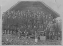 Thumbnail image of The officers and men in a machine gun company posing with their Maxim MG08 machine gun. The plaque in front designates this as the 3rd Machine Gun Company 330th Infantry Regiment.
