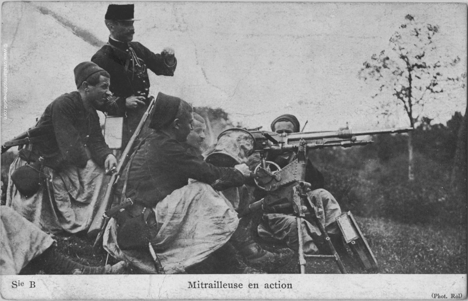 French Zouave (French soldiers from North Africa) training with a 1907/15 St.Etienne machine gun. Note the soldier carrying the bucket to catch the shells during a training exercise. Note the officer directing the fire and the unusually shaped French canteen with separate opening for filling and drinking. The rifles are berthier carbines.
