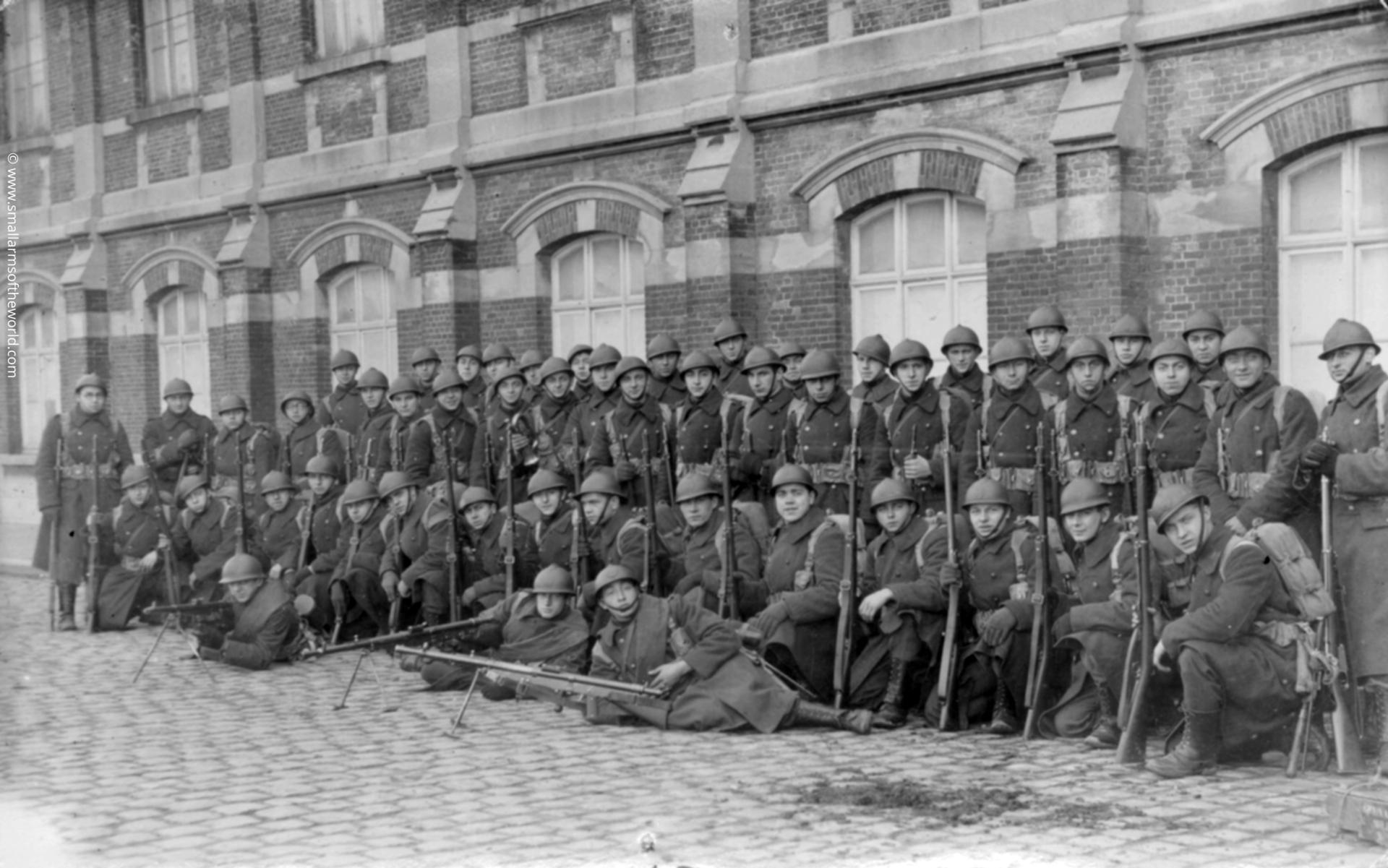 """""""Belgian soldiers with three Chauchat machine guns and Model 1889 rifles. This picture was taken after the men had been in the army for five months, presumably in the early 1920's."""""""