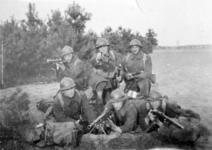 Thumbnail image of A group of six Belgian soldiers with a Belgian caliber Chauchat 1915 machine gun and Mauser rifles.