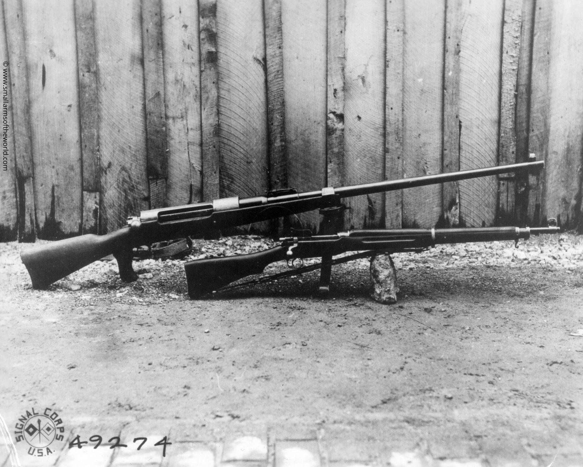Model 1918 13.2 mm Mauser anti-tank bolt action rifle (top) compared with a US Model 1917 Enfield rifle (below). Signal Corps photo.