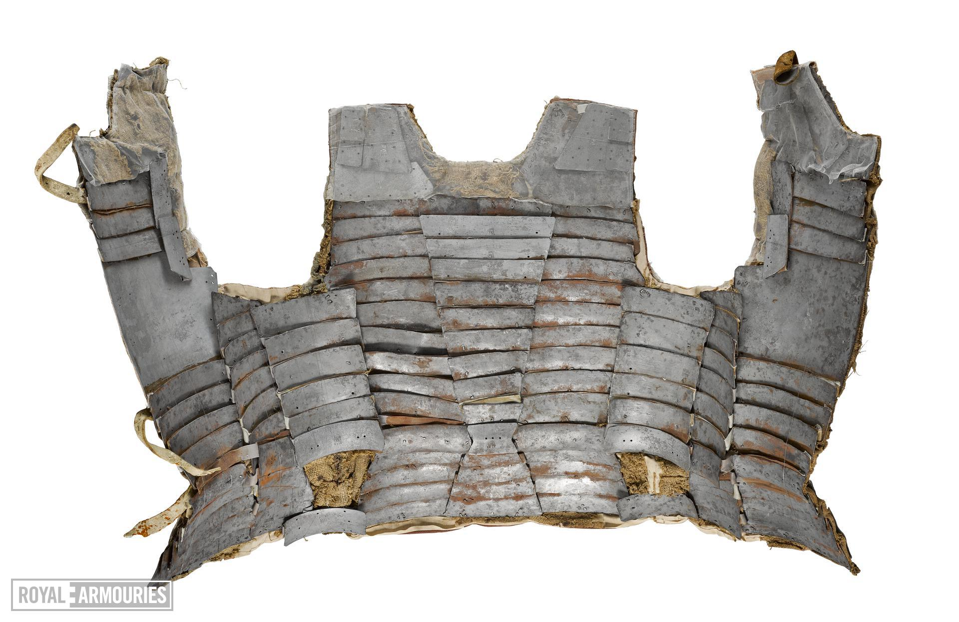 Brigandine (1470), Italy. This rare brigandine protected the torso and comprised numerous, overlapping small plates riveted to an outside textile covering. Relatively light and flexible, it became popular amongst foot soldiers during the 15th century.