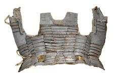 Thumbnail image of Brigandine (1470), Italy. This rare brigandine protected the torso and comprised numerous, overlapping small plates riveted to an outside textile covering. Relatively light and flexible, it became popular amongst foot soldiers during the 15th century.