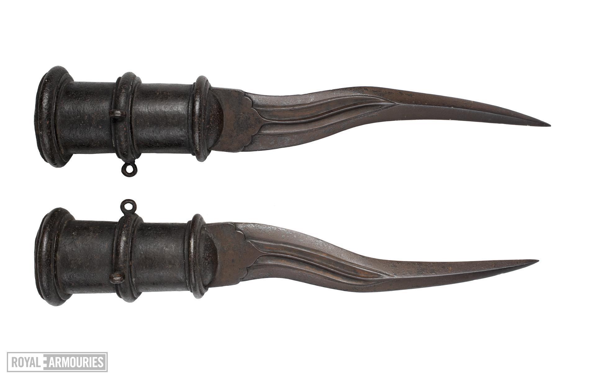 Pair of elephant tusk swords
