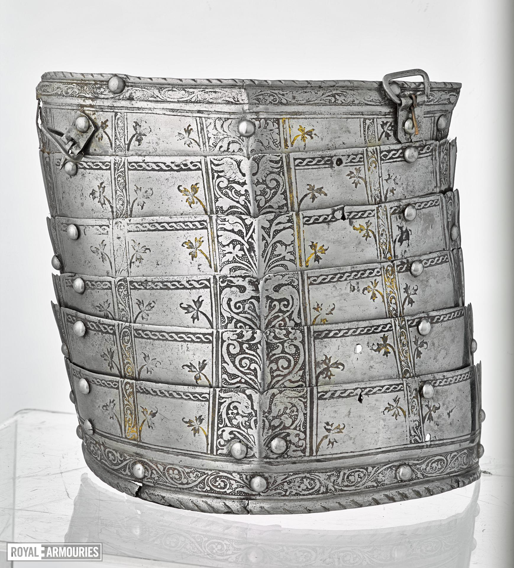 "Right tasset of six lames. Decorated with etched bnands of scrolling foliage. Italian, mid-16th century. Paired with III.710. Referred to as the ""Spiky leaf armour"" (III.709)"