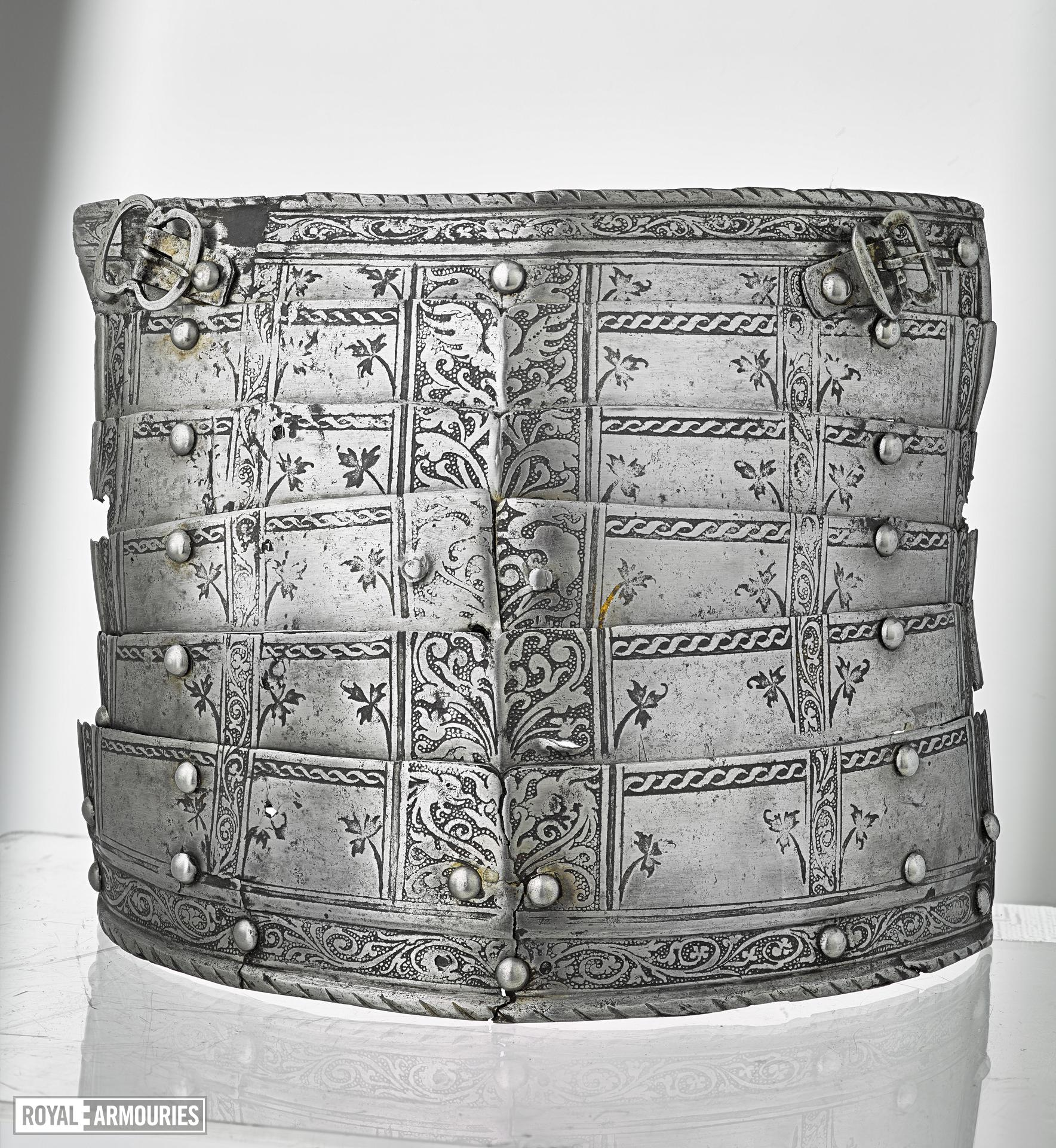"Left tasset of six lames. Decorated with etched bnands of scrolling foliage. Italian, mid-16th century. Paired with III.709. Referred to as the ""Spiky leaf armour"" (III.710)"