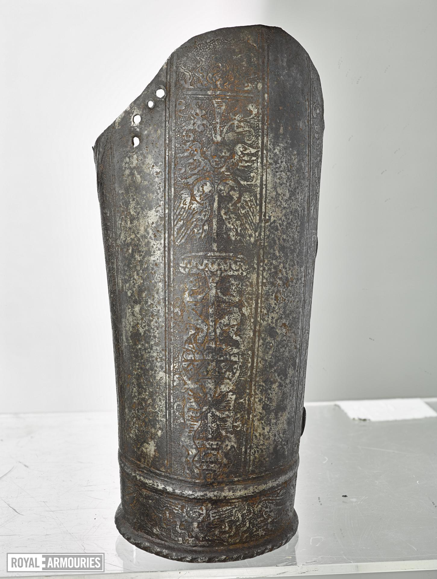 Lower cannon of a left vambrace. Probably from a corslet. Inward turned edge bordered by file-roped rib. Etched with four bands of animals and trees. (III.3645)