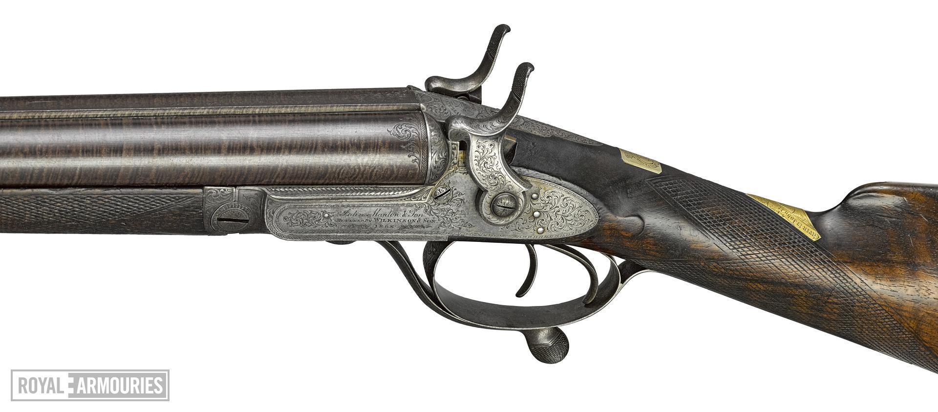 Centrefire breech-loading double-barrelled hammer shotgun