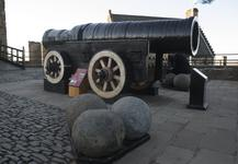 Thumbnail image of Iron bombard known as Mons Meg. Flemish, Mons, mid-15th century (XIX.13) Supplied by Jehan Cambier to Duke Philip the Good of Burgundy. On loan to Historic Scotland and on display at Edinburgh Castle.