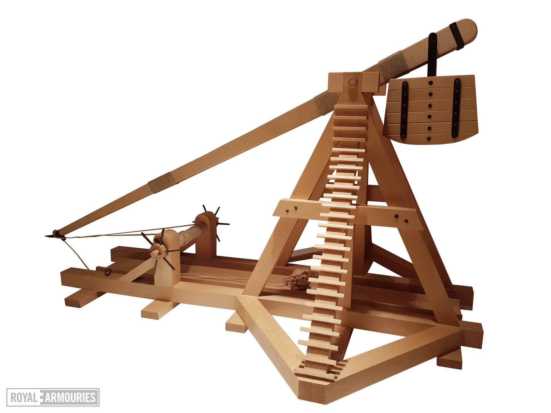 Wooden model of a 13th-century counterpoise trebuchet.The counterweight on the shorter end of the balance arm would be a box of stones. The longer end has a sling in which is secured a stone. British, 1994 (M.90)