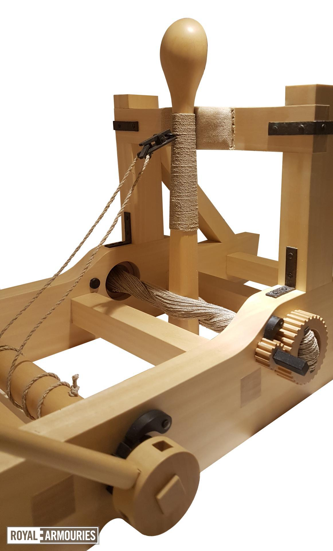 Wooden model of a torsion catapult or mangon. Detal showing the throwing arm through the twisted cords. British, 1994 (M.92)