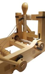 Thumbnail image of Wooden model of a torsion catapult or mangon. Detal showing the throwing arm through the twisted cords. British, 1994 (M.92)