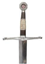 Thumbnail image of Godfrey's (Liam Neeson) / Balian's (Orlando Bloom) retractable special effects sword from the Ridley Scott crusade adventure Kingdom of Heaven (2005). This iconic piece was designed to have been used at various points throughout the film for when the sword is thrust in the direction of another character. The 'Ibelin' sword originally belonged to Godfrey (Liam Neeson) who wielded it valiantly until his death, whereupon it passed to his son Balian (Bloom). The sword is used by Balian for the rest of the film. English, 2004 (IX.5634)