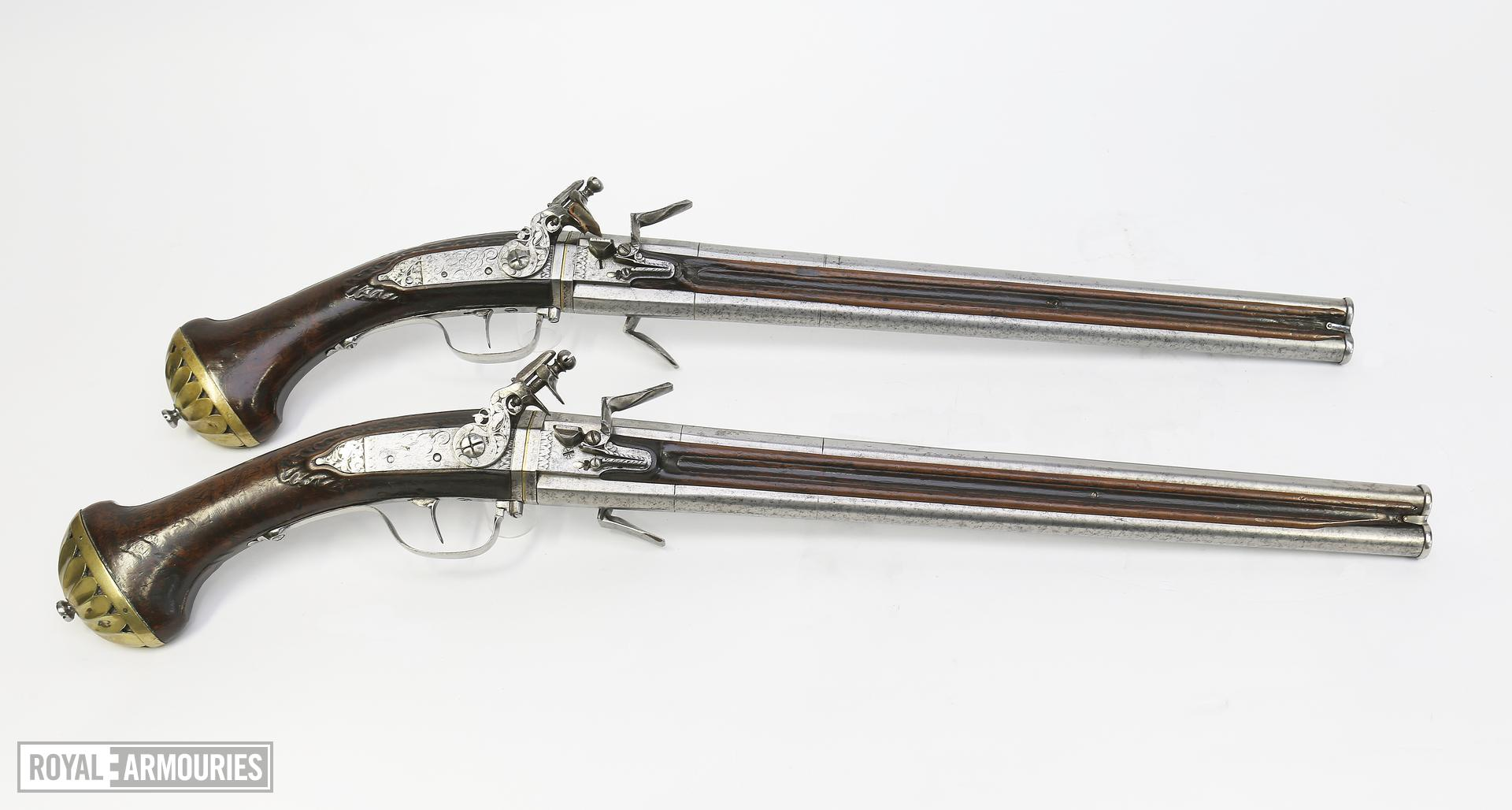 Flintlock double-barrelled pistols By Harman Barne.