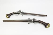 Thumbnail image of Flintlock double-barrelled pistols By Harman Barne.